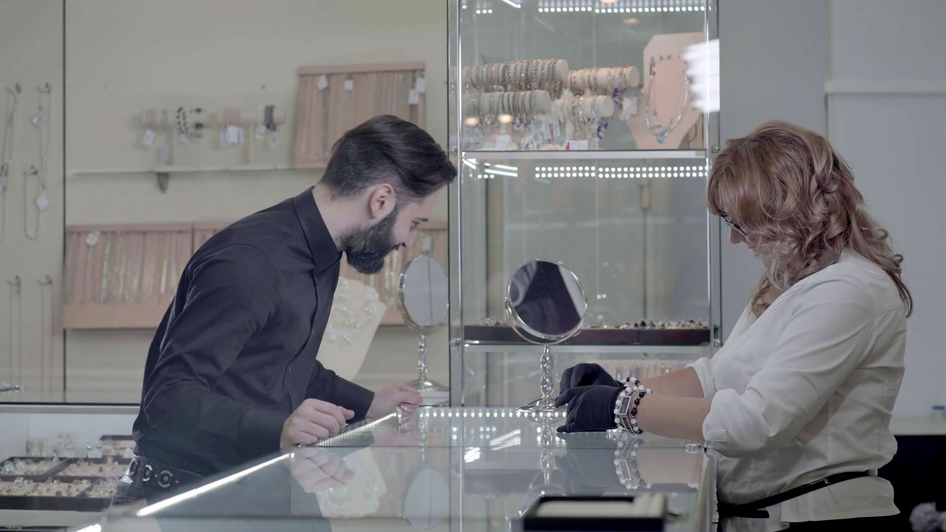 young man in crest jewellery store choosing a engagement ring