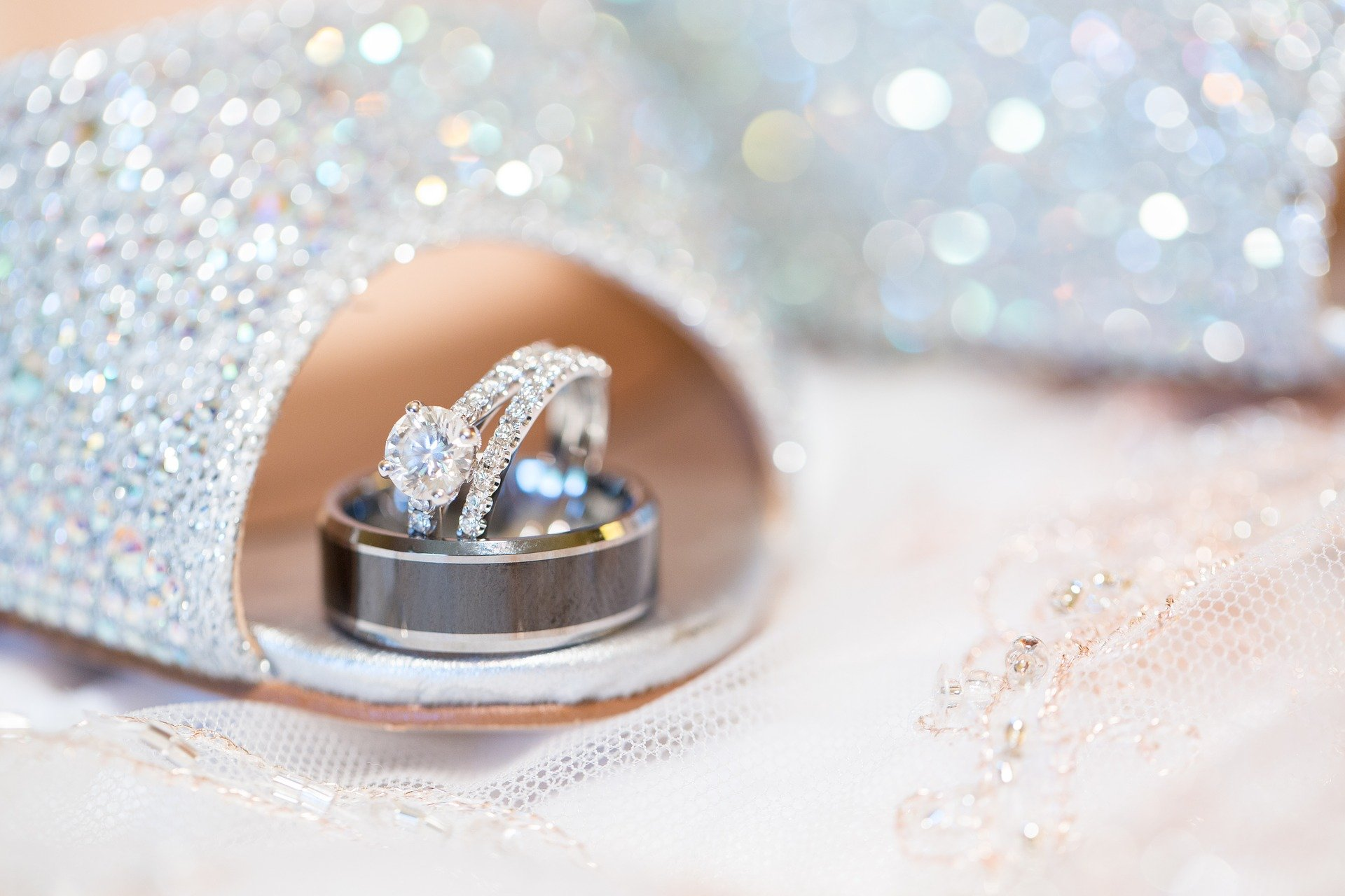 sparkling diamond encrusted wedding ring and band in bride's shoe